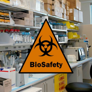 """Biosafety"" and biohazard logo superimposed on a picture of a laboratory workspace"