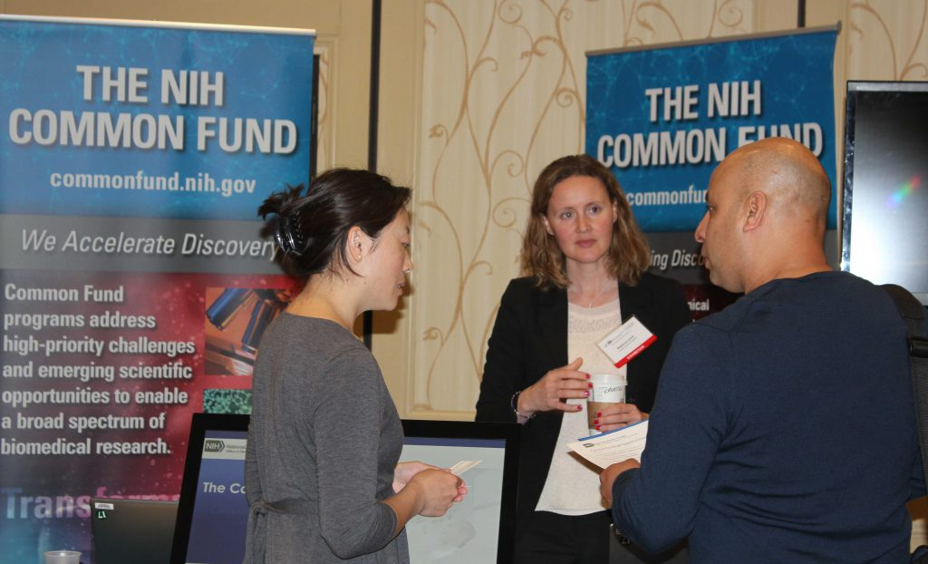 NIH Common Fund staff meet with a seminar attendee